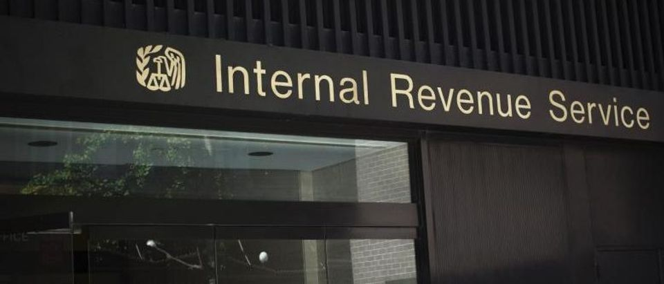 File photo of a woman walks out of the Internal Revenue Service building in New York