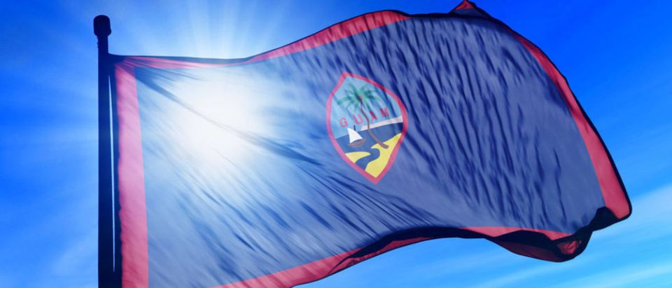 Guam flag waving on the wind (Jiri Flogel/shutterstock_155594351)