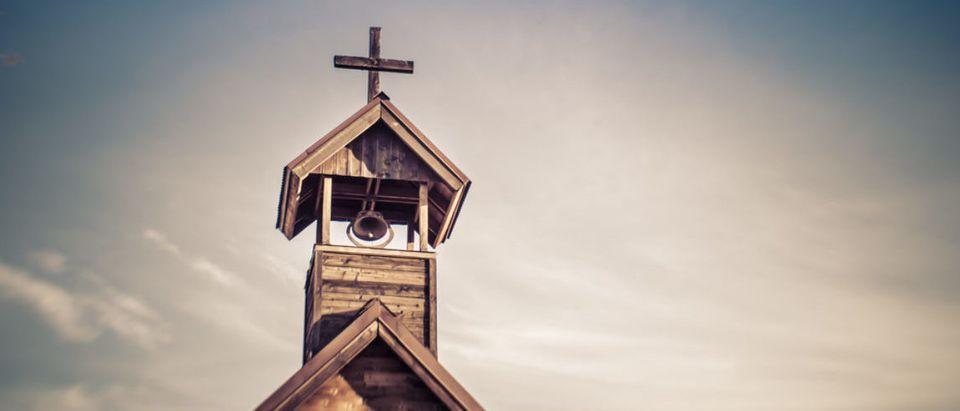 Rural wood church cross (BCFC/shutterstock_177275234)