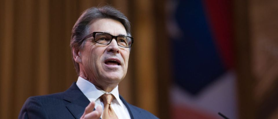 NATIONAL HARBOR, MD - MARCH 7, 2014: Texas Governor Rick Perry speaks at the Conservative Political Action Conference (CPAC). Editorial credit: Christopher Halloran / Shutterstock.com)