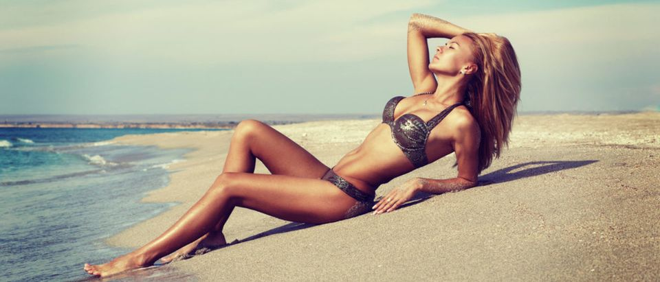Model at the beach (Credit: Shutterstock)