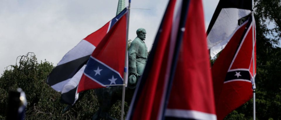 Members of white nationalists rally around a statue of Robert E. Lee in Charlottesville, Virginia, U.S., August 12, 2017. REUTERS/Joshua Roberts