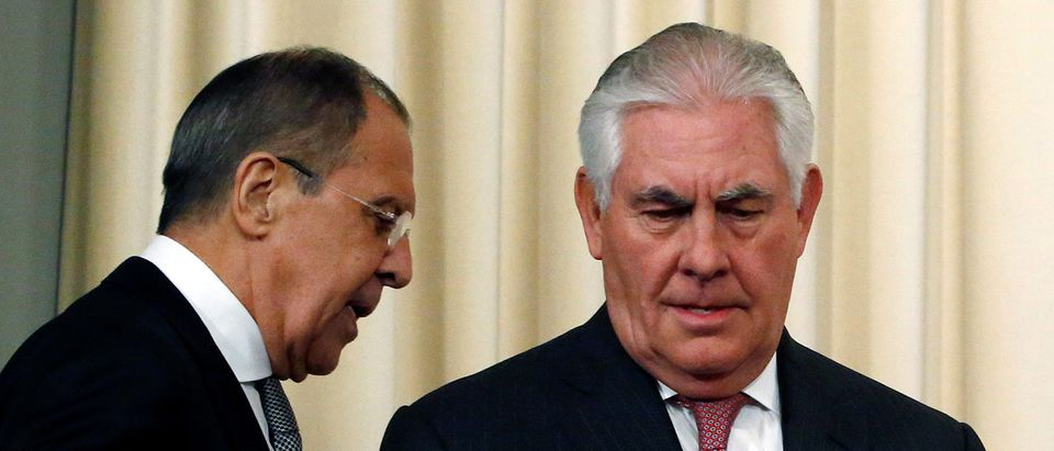 Russian Foreign Minister Sergei Lavrov and U.S. Secretary of State Rex Tillerson arrive for a news conference following their talks in Moscow