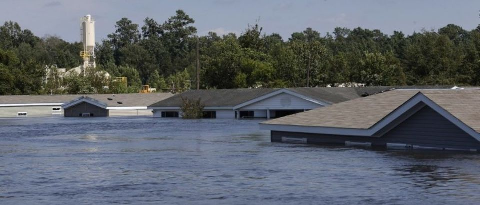 Submerged houses are seen by flood waters from Tropical Storm Harvey in Rose City