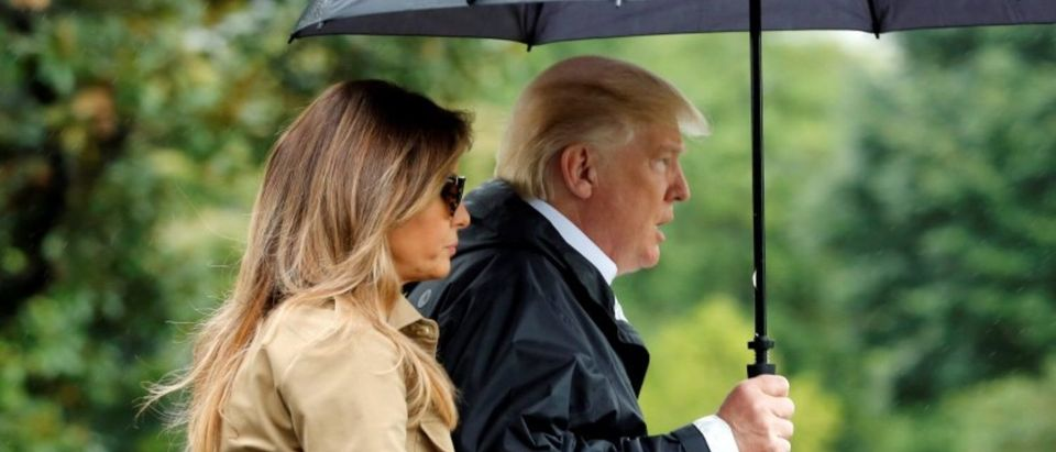 U.S. President Donald Trump and first lady Melania Trump walk on South Lawn of the White House in Washington before their departure to view storm damage in Texas, U.S., September 2, 2017. REUTERS/Yuri Gripas