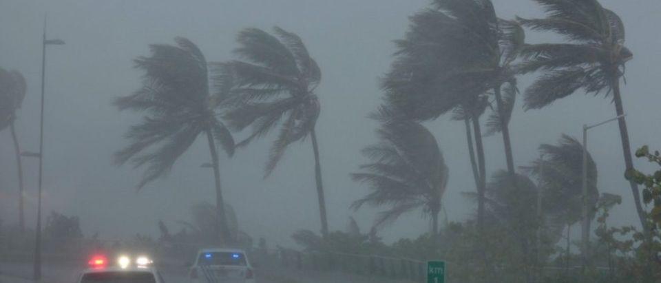 Police patrol the area as Hurricane Irma slams across islands in the northern Caribbean on Wednesday, in San Juan