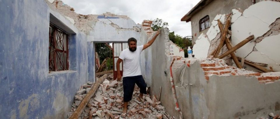Mario Castro explains how he survived with his son inside his house destroyed by the earthquake that struck the southern coast of Mexico late on Thursday, in Ixtaltepec