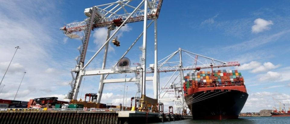 Shipping containers are stacked on a cargo ship in the dock at the ABP port in Southampton