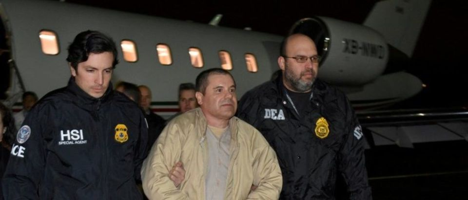 "Mexico's top drug lord Joaquin ""El Chapo"" Guzman is escorted after his extradition from Mexico upon arrival at Long Island MacArthur airport in New York, U.S. on Jan.19, 2017. Courtesy U.S. officials/Handout via REUTERS"