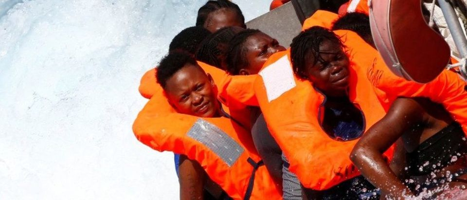 Migrants are rescued by SOS Mediterranee organisation during a search and rescue (SAR) operation with the MV Aquarius rescue ship (not pictured) in the Mediterranean Sea, off the Libyan Coast
