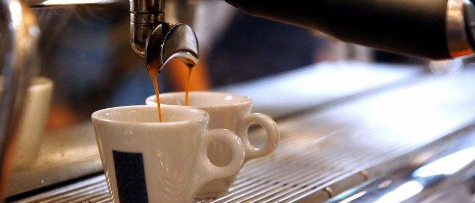 Lavazza coffee flows into cups during the new opening of Lavazza's flagship coffee store downtown Milan
