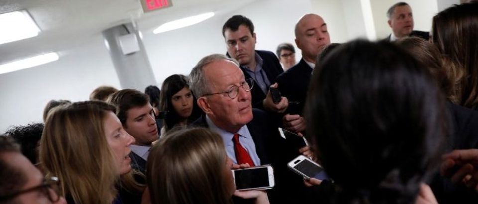 Sen. Lamar Alexander (R-TN) speaks with reporters ahead of the party luncheons on Capitol Hill in Washington