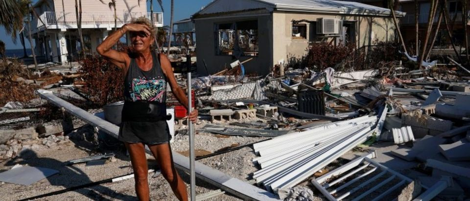 A woman surveys the damage to her mother's house following Hurricane Irma in Big Pine Key