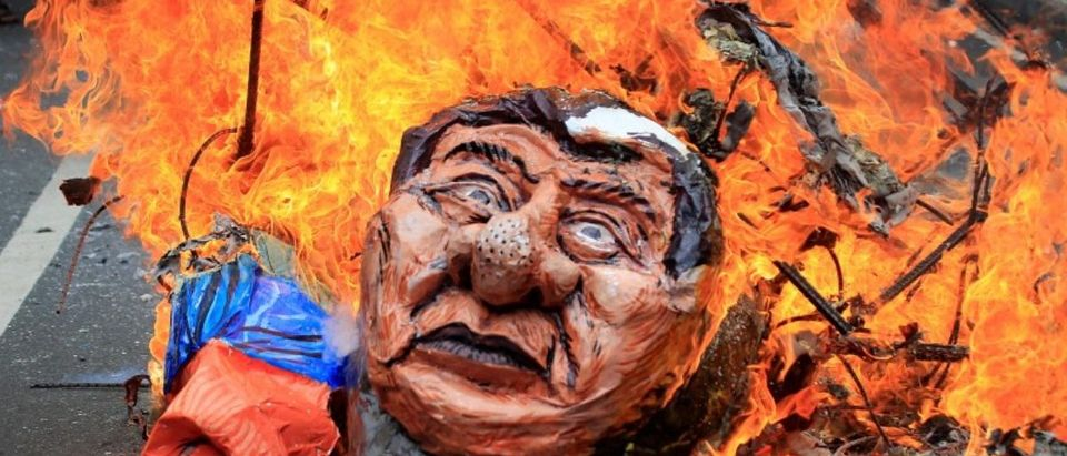 Protesters burn an effigy of Philippine President Rodrigo Duterte to express their outrage while calling for the immediate pullout of U.S. troops in Mindanao province, southern Philippines, during a protest outside the U.S. embassy in metro Manila, Philippines September 15, 2017. REUTERS/Romeo Ranoco