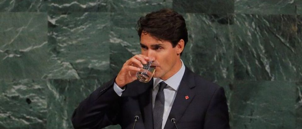 Canadian Prime Minister, Justin Trudeau, takes a drink as he addresses the 72nd United Nations General Assembly at U.N. headquarters in New York