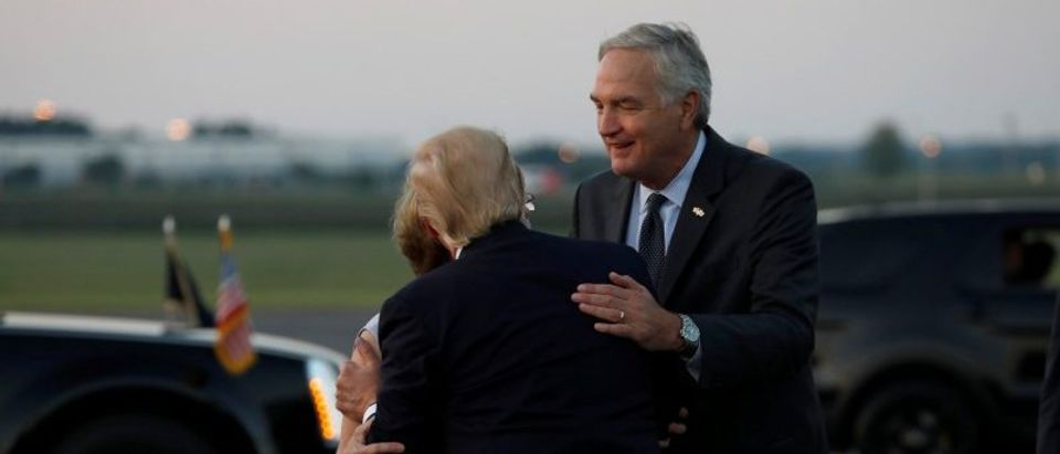 President Donald Trump greets Sen. Strange and his wife as he arrives at Huntsville International Airport in Huntsville