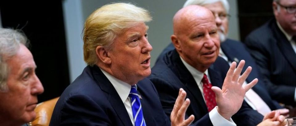 U.S. President Donald Trump, flanked by U.S. Representative Kevin Brady (R-TX), meets with members of the House Ways and Means Committee about proposed changes to the U.S. tax code at the White House in Washington, U.S. September 26, 2017. REUTERS/Jonathan Ernst