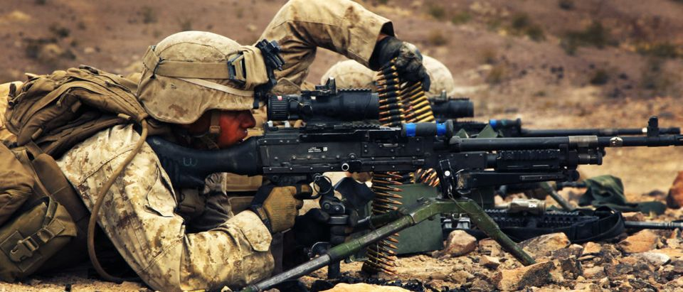 Marines with 1st Battalion, 9th Marine Regiment, reload their 240B machine gun at a support by fire-position during a company-sized attack on Range 401 at Marine Corps Air Ground Combat Center, Twentynine Palms, Calif., July 26. The battalion is currently conducting the Integrated Training Exercise in preperation of their upcoming deployment to Afghanistan later this year. (U.S. Marine Corps photo by Cpl. Ali Azimi/released)