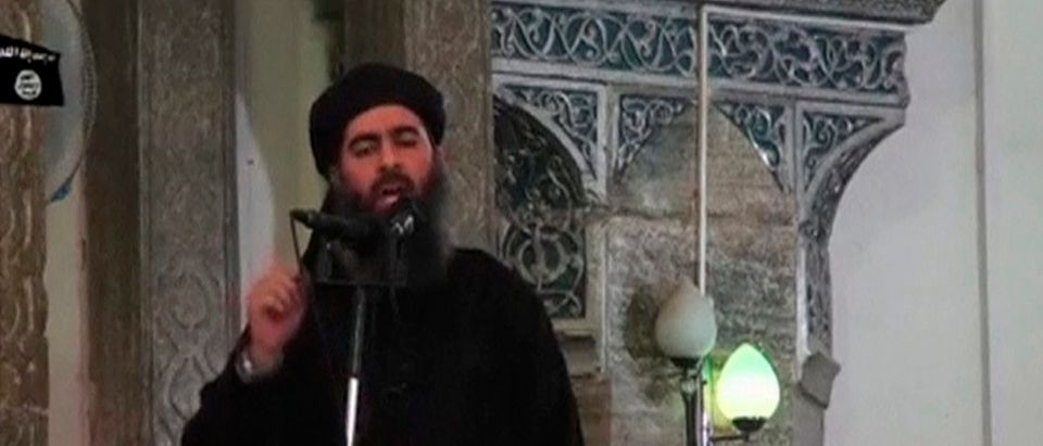 A man purported to be the reclusive leader of the militant Islamic State Abu Bakr al-Baghdadi has made what would be his first public appearance at a mosque in the centre of Iraq's second city, Mosul, according to a video recording posted on the Internet on July 5, 2014, in this still image taken from video. There had previously been reports on social media that Abu Bakr al-Baghdadi would make his first public appearance since his Islamic State in Iraq and the Levant (ISIL) changed its name to the Islamic State and declared him caliph. The Iraqi government denied that the video, which carried Friday's date, was credible. It was also not possible to immediately confirm the authenticity of the recording or the date when it was made. (REUTERS/Social Media Website via Reuters TV)