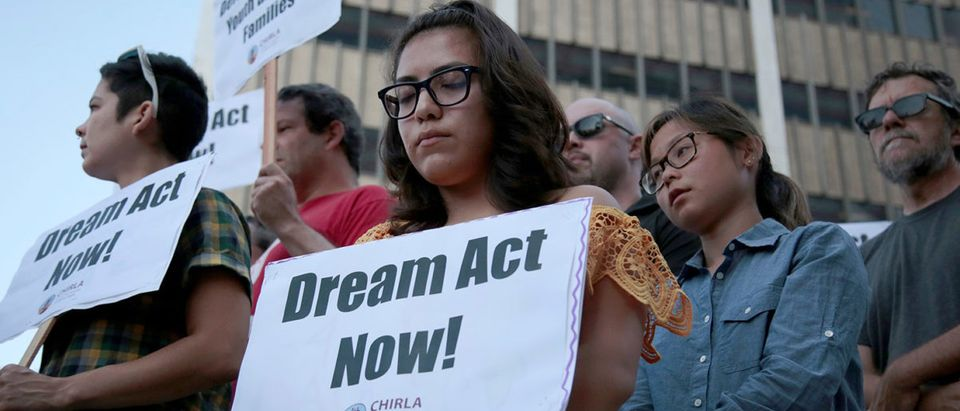 Alejandra Garcia, center, stands with supporters of the Deferred Action for Childhood Arrivals program during a rally outside the Edward R. Roybal Federal Building in Los Angeles, California