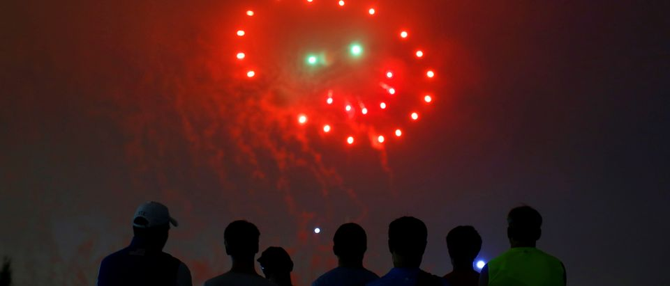 People watch fireworks in the form of a 'smiley face' during the 4th of July Independence Day celebrations at the National Mall in Washington, U.S.