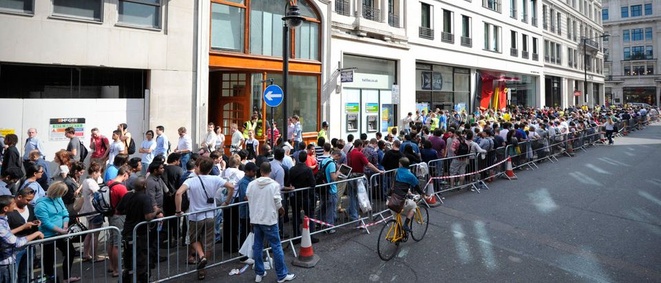 Shoppers queue outside an Apple store in