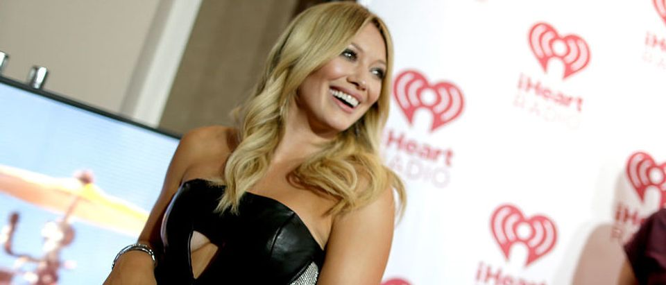 Hilary Duff arriving at the 2014 iHeartRadio Music Festival at the MGM Grand Garden Arena in September 2014 in Las Vegas, Nevada. (Photo by Isaac Brekken/Getty Images for iHeartMedia)