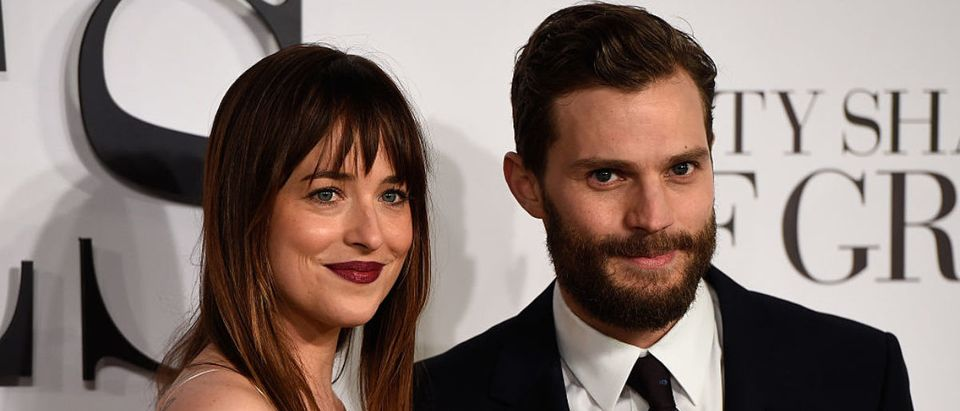 LONDON, ENGLAND - FEBRUARY 12: Dakota Johnson and Jamie Dornan attend the UK Premiere of 'Fifty Shades Of Grey' at Odeon Leicester Square on February 12, 2015 in London, England. (Photo by Ian Gavan/Getty Images)