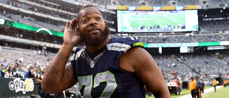 EAST RUTHERFORD, NJ - OCTOBER 02: Michael Bennett #72 of the Seattle Seahawks listens to the screaming fans as he exits the field after the game against the New York Jets at MetLife Stadium on October 2, 2016 in East Rutherford, New Jersey. (Photo by Elsa/Getty Images)