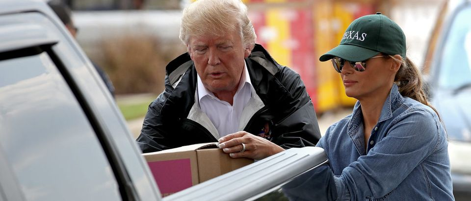 U.S. President Donald Trump and first lady Melania Trump load emergency supplies into the bed of a pickup truck for residents impacted by Hurricane Harvey while visiting the First Church of Pearland September 2, 2017 in Pearland, Texas. Pearland, just south of Houston, was heavily damaged by the floodwaters created by the hurricane. (Photo: Win McNamee/Getty Images)