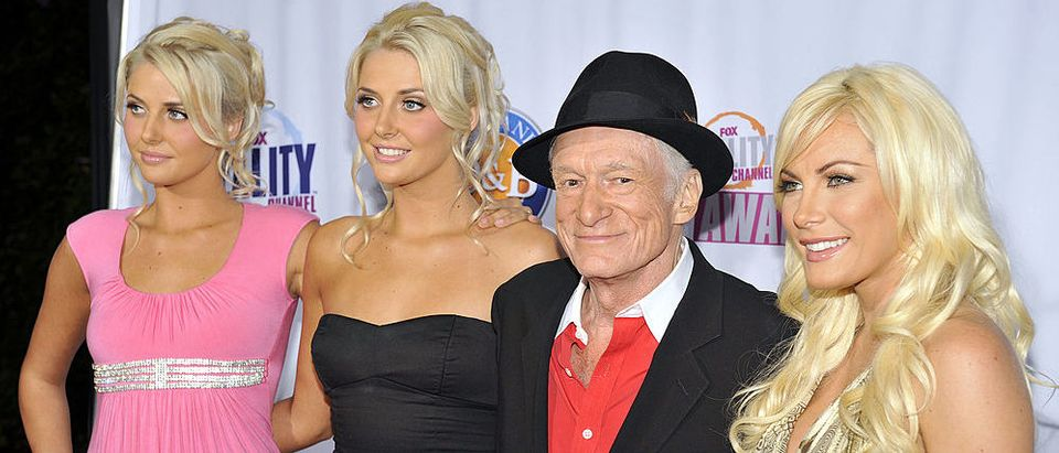 Hugh Hefner and the new Girls Next Door pose for a picture at the 2009 Fox Reality Channels Really Awards held at The Music Box @ Fonda on October 13, 2009 in Los Angeles, California. (Photo by Toby Canham/Getty Images)