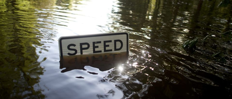 Flood waters engulf a speed limit sign after Hurricane Irma in Jacksonville