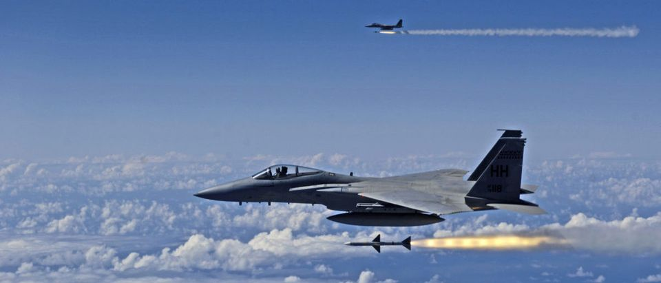 US Air Force F-15 Eagle fires AIM-7 Sparrow missiles at a tactical air-launched decoy during exercise Rim of the Pacific 2006 off the coast of Hawaii