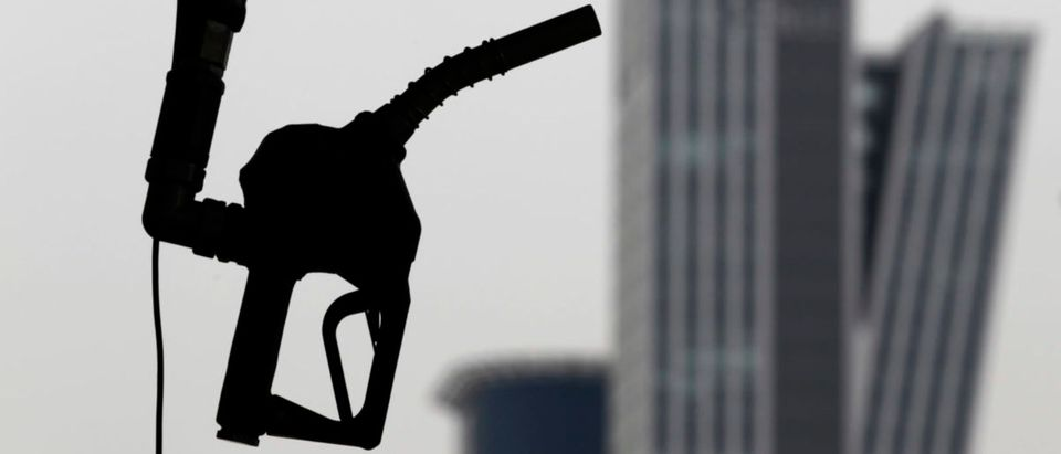 A gasoline pump is seen hanging at a petrol station in central Seoul April 6, 2011. (Photo: REUTERS/Lee Jae-Won)