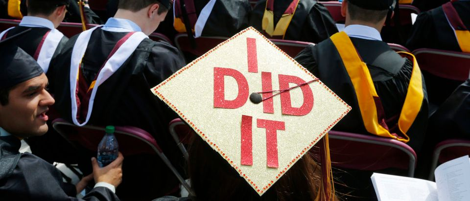 "Graduating student Katherine Thomas has ""I Did It"" written on her mortar board during Commencement Exercises at Boston College in Boston, Massachusetts May 19, 2014. REUTERS/Brian Snyder (UNITED STATES - Tags: EDUCATION SOCIETY) - GM1EA5K019X01"