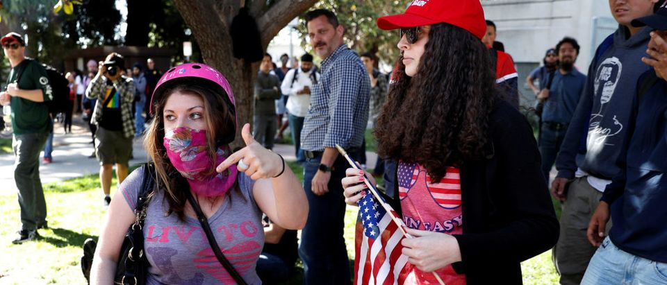 Protesters gather over the cancelation of conservative commentator Ann Coulter's speech at the University of California, Berkeley, in Berkeley, California, U.S., April 27, 2017. REUTERS/Stephen Lam