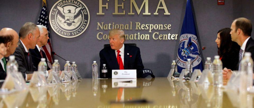 U.S. President Donald Trump attends a Federal Emergency Management Agency (FEMA) briefing on hurricane season at FEMA Headquarters in Washington, U.S., August 4, 2017. REUTERS/Carlos Barria - RC1182D7F400