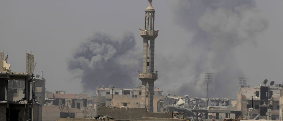 Smoke rises after an air strike during fighting between members of the Syrian Democratic Forces and Islamic State militants in Raqqa