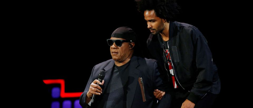 Stevie Wonder takes a knee with the help of his son Kwame Wonder before performing at the 2017 Global Citizens Festival at Central Park in New York, U.S., September 23, 2017. REUTERS/Shannon Stapleton
