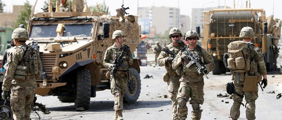 U.S. and NATO troops arrive at the site of a car bomb attack in Kabul, Afghanistan. September 24, 2017. REUTERS/Omar Sobhani