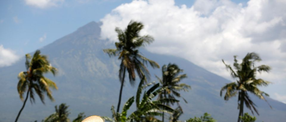 Mount Agung, a volcano which had its alert status raised to the highest level last week, is seen as a farmer tends her crops, near Amed, on the resort island of Bali, Indonesia September 29, 2017. REUTERS/Darren Whiteside - RC11D0ACCAE0 (Reuters)