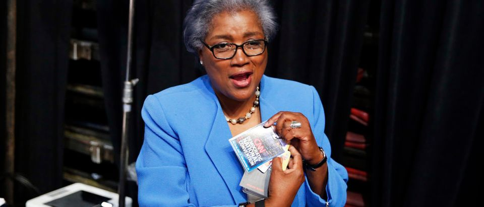 Acting DNC Chair Donna Brazile removes her CNN credential so she may participate in the Democratic National Convention in Philadelphia, Pennsylvania, U.S. July 25, 2016. REUTERS/Lucy Nicholson
