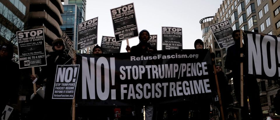Anti-Trump demonstrators organized by RefuseFascism.org march through the streets of Washington