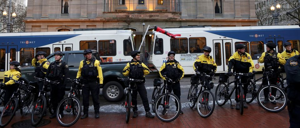 Police wait outside a demonstration protesting the inauguration of U.S. President Donald Trump in Portland, Oregon