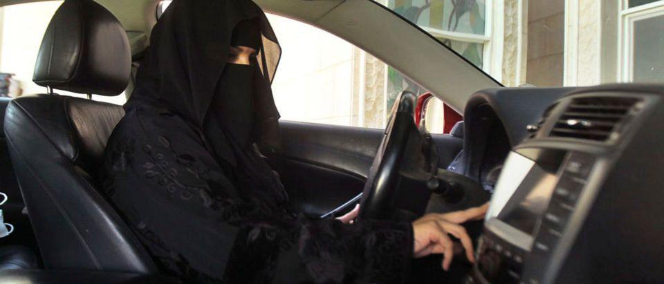 A Saudi Woman Behind The Wheel Of A Car October 22, 2013. REUTERS/Faisal Al Nasser