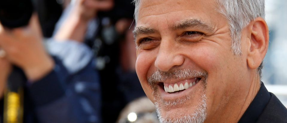 """Cast member George Clooney poses during a photocall for the film """"Money Monster"""" out of competition at the 69th Cannes Film Festival in Cannes"""