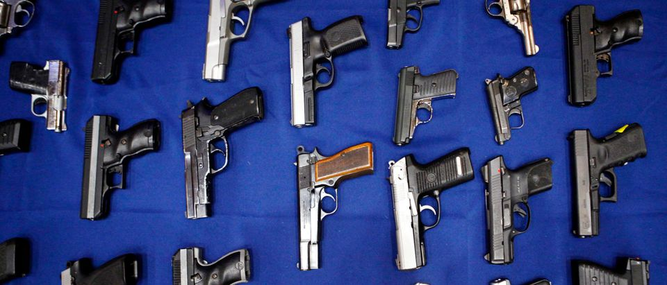 Seized handguns are pictured at the police headquarters in New York, New York August 19, 2013. REUTERS/Eric Thayer/File Photo