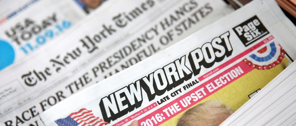 The cover of the New York Post newspaper is seen with other papers at a newsstand in New York