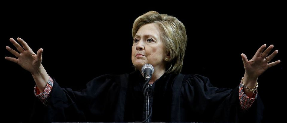 Former Secretary of State Hillary Clinton speaks on stage during a commencement for Medgar Evers College in the Brooklyn borough of New York City
