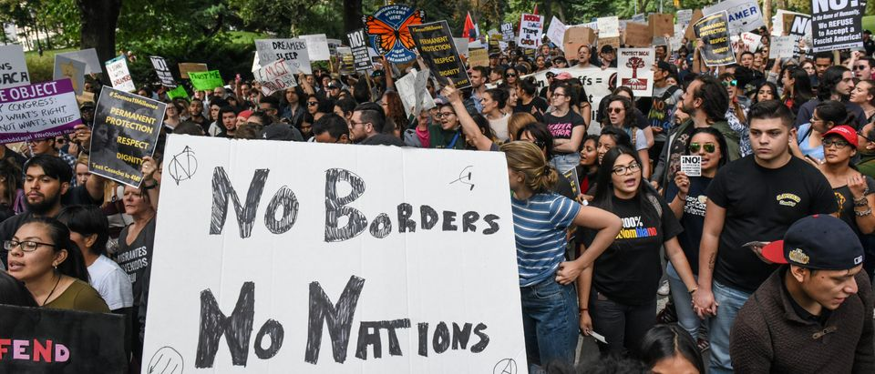 People participate in a protest in defense of the Deferred Action for Childhood Arrivals program or DACA in New York, NY